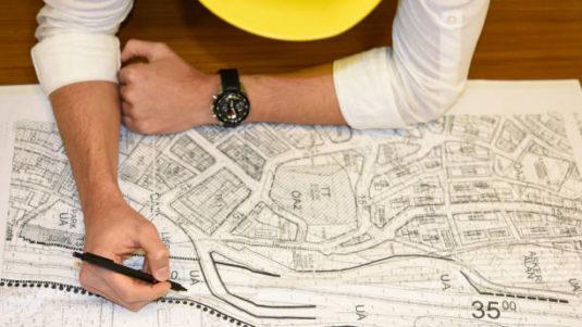 Civil engineer working at blueprints
